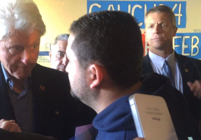 Secret Service keep an eye on Former President Bill Clinton at the Hillary Campaign Headquarters during the 2016 Nevada Democratic Caucus